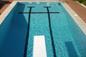 Piscina a skimmer in cemento armato 5x10, rivestita in piastrelle con trampolino
