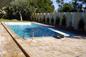 Piscina a skimmer in cemento armato 6x12 rivestita in piastrelle con trampolino